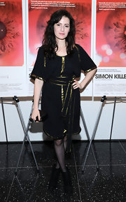 Aleksa Palladino chose this loose-fitting black dress with metallic gold trim for her cool evening look while at the 'Simon Killer' New York premiere.