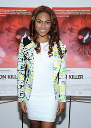 Tashiana Washington kept her evening look bright and springy with this white shift dress and a colorful blazer.