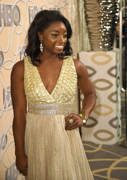 Simone Biles Gold Ring [clothing,dress,fashion,fashion design,formal wear,cocktail dress,event,haute couture,gown,jewellery,simone biles,official golden globe awards,beverly hills,california,circa 55 restaurant,hbo,party,red carpet]