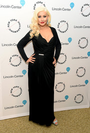 Christina Aguilera oozed Old Hollywood glamour in a draped black wrap gown by Versace at the Sinatra Voice for a Century event.