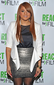 Marsha Ambrosius wore a cropped white jacket with a black blouse and a silver skirt for a super stylish finish at the 'Sing Your Song' screening.