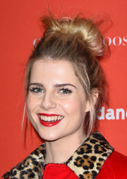 Lucy Boynton's red lipstick was a perfect match to her coat!