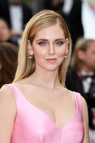 Chiara Ferragni teamed her earrings with a cute gold charm necklace.