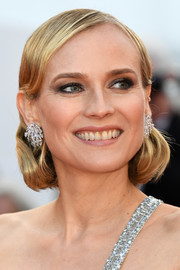 Diane Kruger complemented her bedazzled dress with a pair of diamond earrings by Chopard.