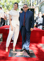 Hailee Steinfeld matched her top with white trousers.