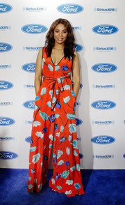 Regina Hall was spring-chic in a red floral jumpsuit on day 1 of Essence Festival.
