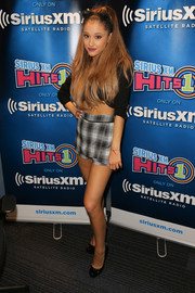 Ariana Grande went to the Morning Mash-Up broadcast rocking a pair of cute plaid shorts and a crop-top.