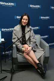 Eva Chen bundled up in a cozy gray wool coat for her SiriusXM interview.