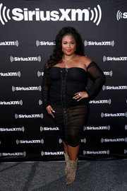 Lizzo flashed some skin in a sheer, off-the-shoulder LBD at Super Bowl LIV.
