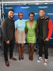 Lupita Nyong'o teamed printed pumps with an acid-green dress for her visit to SiriusXM's 'Town Hall.'