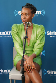 Lupita Nyong'o looked fierce in an acid-green leather dress while visiting SiriusXM's 'Town Hall.'