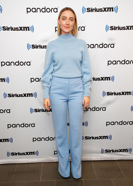 Saoirse Ronan matched her top with a pair of pastel-blue straight-leg trousers.