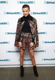 Millie Bobby Brown rocked a floral jacquard skirt suit by Giamba while visiting SiriusXM's 'Town Hall.'