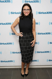 A black-and-white grid-print pencil skirt provided a chicer finish.