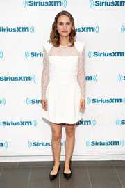 Natalie Portman looked angelic in a white romper with a lace yoke and sleeves while visiting SiriusXM Town Hall.