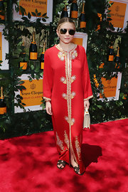 Ashley Olsen rocker her signature boho style with this free-flowing red maxi that featured gold embellishments.