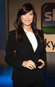 Ilaria D'Amico attended the Sky Go press conference with her nails painted primary red.