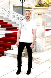 Ola Rapace attended the James Bond photocall for 'Skyfall' wearing a basic white graphic T-shirt.