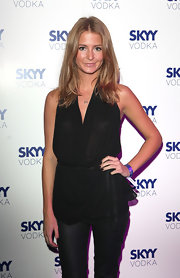 Millie Mackintosh posed for the Skyy Vodka event wearing a simple sexy ensemble featuring a halter top from Helmut Lang.