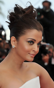 Aishwarya Rai pinned her brunette locks in a sculpted updo for the Cannes Film Festival.