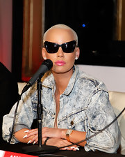Amber Rose wore a stark white polish on her ultra-long stiletto nails while participating in a panel discussion.