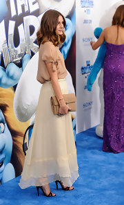 Olivia Palermo kept her summery style at 'The Smurfs' premiere neutral with the addition of a tan leather clutch.