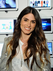 Nikki Reed styled her signature hombre tresses in a classic long wavy 'do.