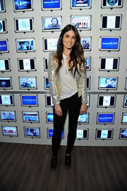 Nikki Reed kept her look casual but dressy with this gold leather jacket.