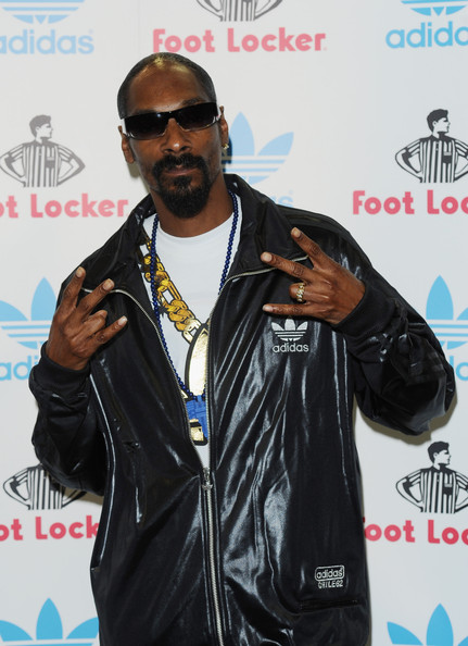 Snoop Dogg showed off his rectangle sunglasses while hitting a Footlocker appearance.