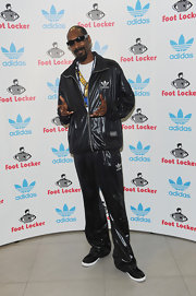 Snoop paired his matching track pants with a track jacket while attending a Footlocker appearance.
