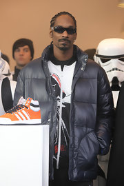 Snoop made an appearance sporting classic corn rows and designer shades.