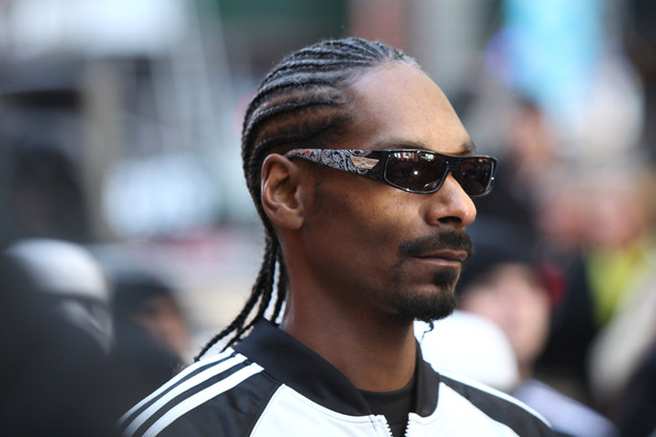 Day or night, Snoop always tops off his look with a stylish pair of designer shades.