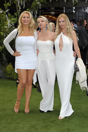 Victoria rocked the summery LWD trend in curve-clinging halter dress with delicate chain straps.