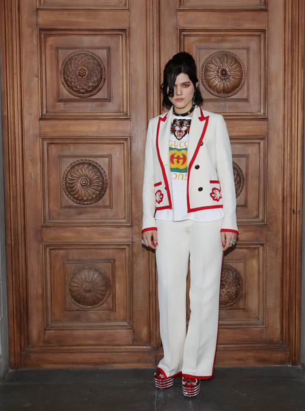 SoKo Pantsuit [clothing,suit,formal wear,outerwear,uniform,blazer,pantsuit,tuxedo,jacket,trousers,cruise 2018 - arrivals,palazzo pitti,florence,italy,gucci,soko,fashion show,gucci cruise 2018]