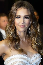 Jessica Alba's full pout looked super shiny and supple thanks to a soft pink gloss.