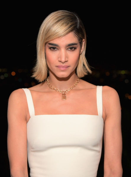 Sofia Boutella Gold Pendant [hair,face,blond,hairstyle,shoulder,beauty,eyebrow,lip,lady,chin,gq men of the year party,sofia boutella,caption,chateau marmont,gq,dior homme,getty images,host a private dinner in celebration,dinner,celebration]