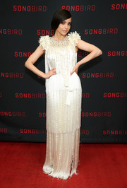 Sofia Carson was vintage-glam in a fringed ivory gown by Prada at the celebration of the release of her new movie, 'Songbird.'