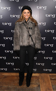 Maria dons a thick fur coat with a beret and slim pants at Sundance.