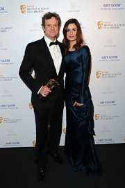 Colin Firth's wife wore her hair in long flowing waves.