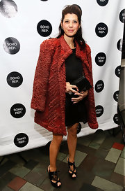 Marisa Tomei draped her red ruffled evening coat over her shoulders to mimic a cape while at the Soho Rep's 2013 Spring Gala.