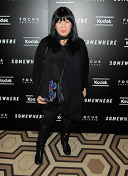 Anna Sui gave her funky look an edge with black flat boots.