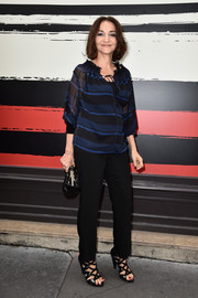Nathalie Rykiel donned a striped peasant blouse with black slacks for the Sonia Rykiel fashion show.