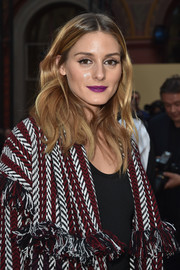 Olivia Palermo coated her kissers an eye-popping purple hue.