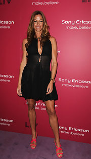 Kelly Bensimon brought her outfit right into spring with a pair of hot pink strappy sandals. The color was a great way to add some character to her simple black dress.