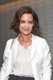 Katie Holmes' Jennifer Meyer turquoise pendant gave her white outfit a welcome pop of color at the LA premiere of 'The Wife.'
