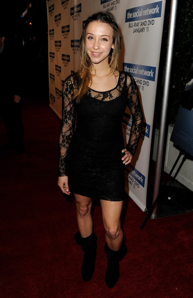 Stella dressed down her lacy black dress with black mid-calf boots.