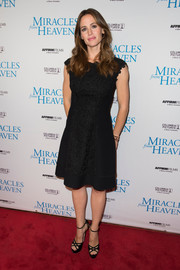 Jennifer Garner chose black cutout platform sandals by Jimmy Choo to complete her red carpet outfit.