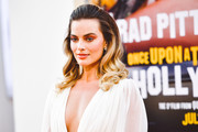 Margot Robbie wore a half-up style with curly ends at the LA premiere of 'Once Upon a Time in Hollywood.'