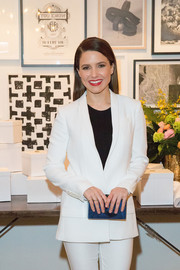 Sophia Bush teamed a blue box clutch with a white pantsuit for a minimalist-chic look during the brunch celebrating Chicago's top design tastemakers.