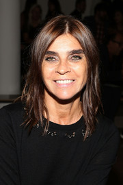 Carine Roitfeld opted for a simple center-parted, layered hairstyle when she attended the Sophie Theallet fashion show.